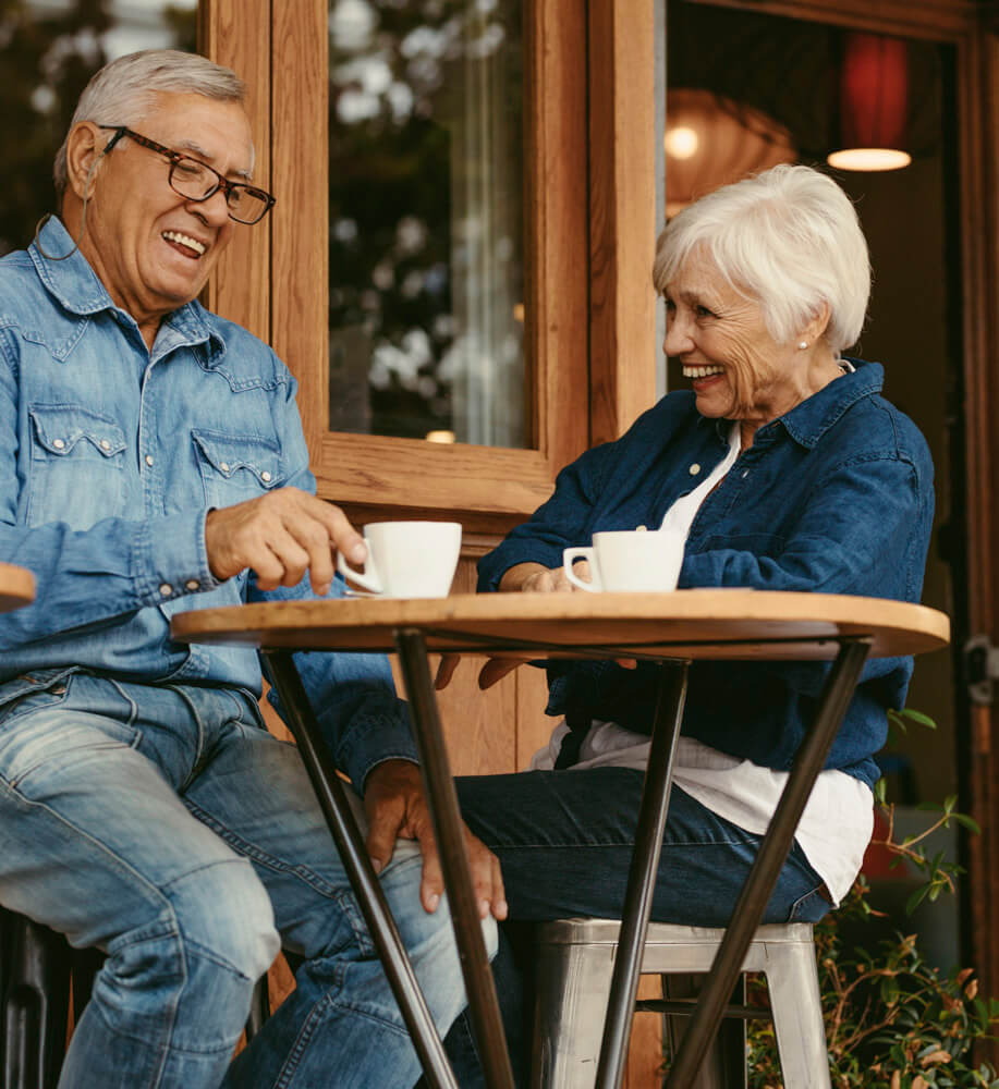 Senior couple having conversation at cafe